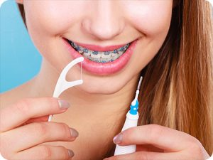 exeter pa orthodontist how to floss with braces